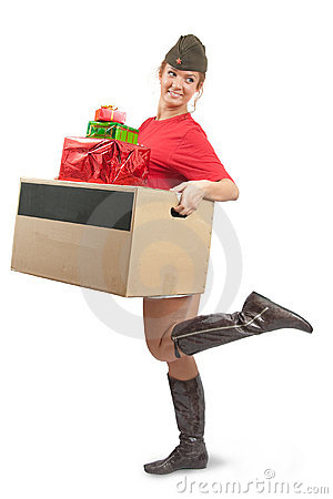 Beauty girl in garrison cap with christmas gifts