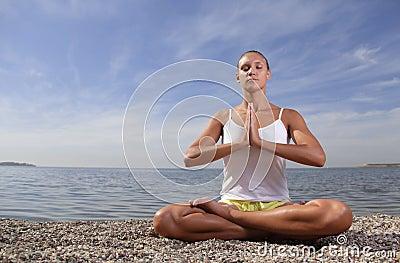 Beauty girl in lotus pose