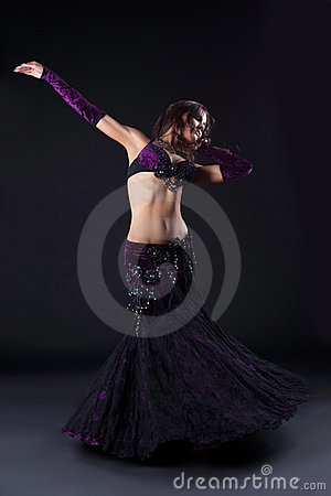 Beauty girl in oriental purple arabic costume