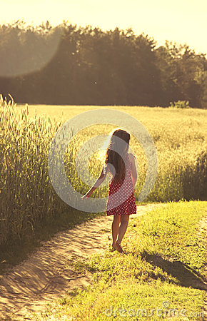 Free Beauty Girl Outdoors Enjoying Nature. Beautiful Little Girl In Red Dress Running On The Spring Field. Toned Stock Image - 50451741