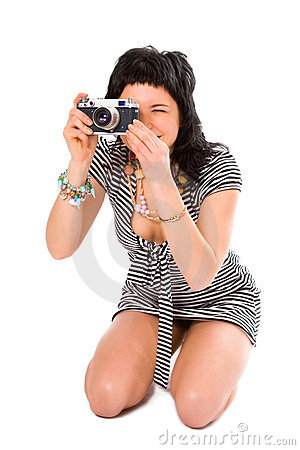 Beauty girl photographer in sailor s vest with photo camera