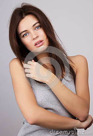 Beauty Girl. Portrait of Beautiful Young Woman looking at Camera