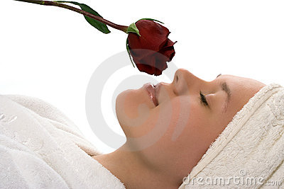 Beauty girl in towel with rose after shower