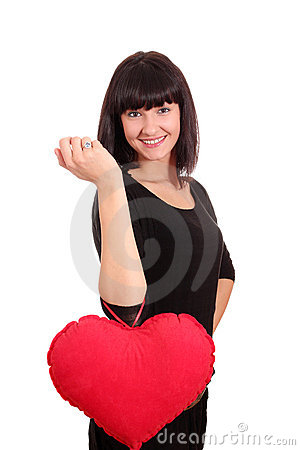 Beauty girl with valentine heart posing