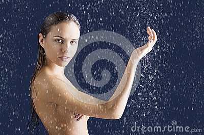 Beauty girl with wet skin with raised arm