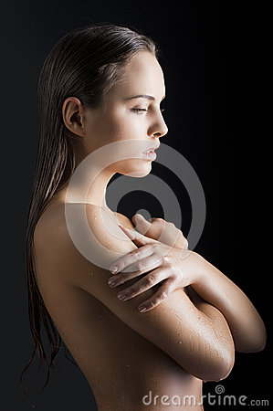 Beauty girl with wet skin turned in profile