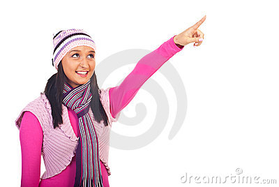 Beauty girl in winter clothes pointing