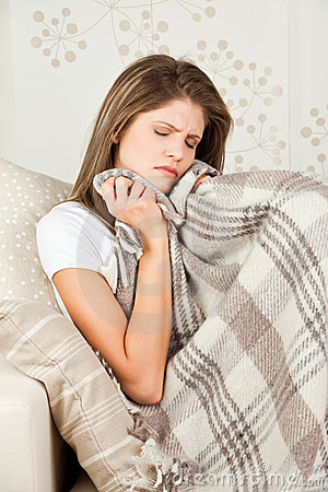 Beauty girl with wool blanket resting in bed