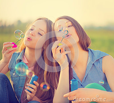 Free Beauty Girls Blowing Soap Bubbles In Spring Park Royalty Free Stock Photo - 69698855