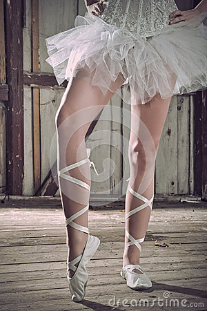 Beauty legs of ballerina standing in pointes