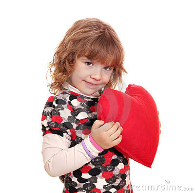Beauty little girl holding red heart
