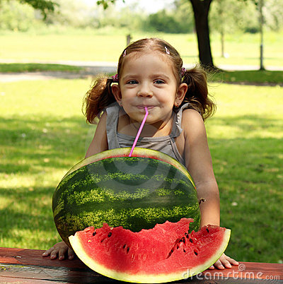 Beauty little girl with watermelon