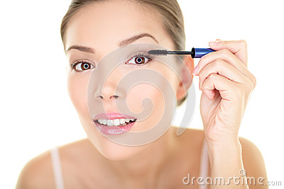 Beauty makeup woman putting mascara eye make up