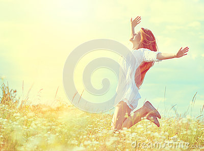 Beauty model girl in white dress jumping