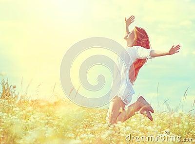 Beauty model girl in white dress jumping
