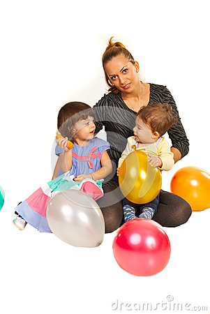 Beauty mother with two kids at party