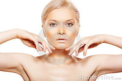 Beauty with natural day make-up touching her face