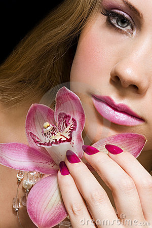 Beauty with pink orchid