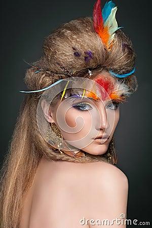 Beauty portrait in feathers