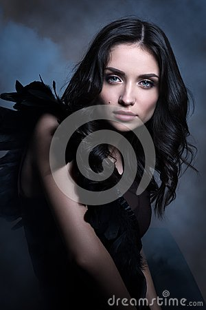 Free Beauty Portrait In Cool Tones. Beautiful Young Woman In A Dark Way In The Cloud Of Smoke Royalty Free Stock Photo - 108617275
