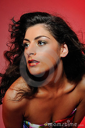 Beauty portrait of pretty woman with curly hair