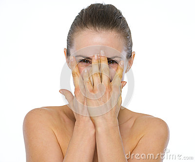Beauty portrait of young woman hiding behind hands