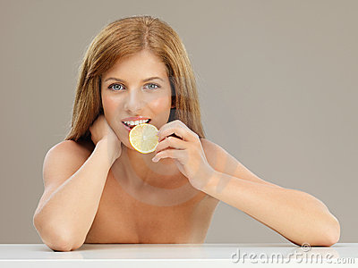 Beauty portrait young woman tasting lemon