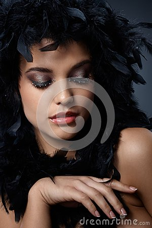 Beauty posing with black boa