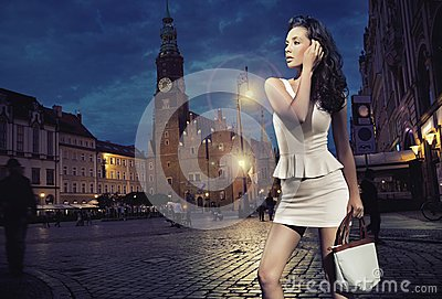 Beauty posing over night city background