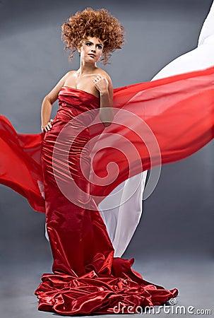 Beauty redheaded girl in fashion dress