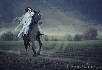 Beauty riding a horse