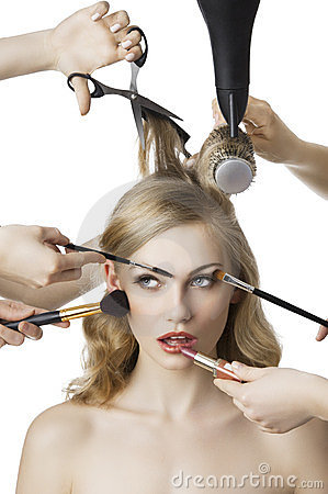In beauty salon, the girl looks up at right