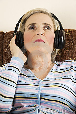 Beauty senior woman listen music