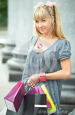 Beauty shopping girl with packet