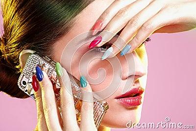 Beauty shot of model wearing colorful nail polish