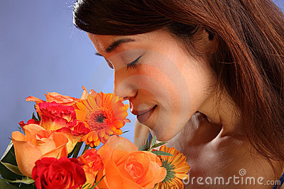 Beauty shot young Japanese girl smelling flowers