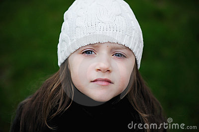 Beauty small girl with blue eyes in white hat
