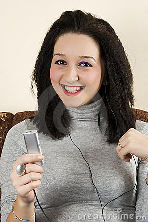 Beauty smiling teen listen music