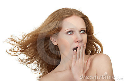 Beauty surprised amazed girl with flowing hair