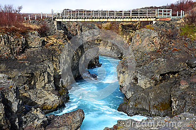 Beauty waterfall Hraunfossar on the Iceland Editorial Image