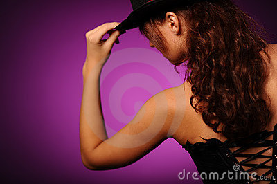 Beauty woman in black corset and silk hat
