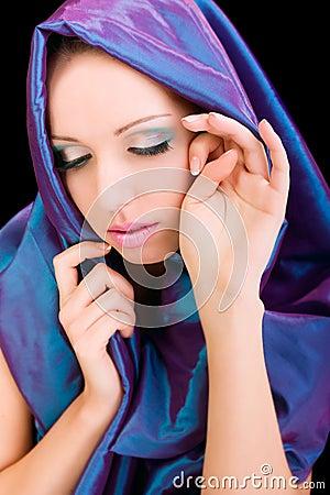 Beauty woman blue cloth face makeup studio shot