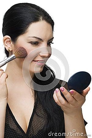 Beauty woman blushing in mirror