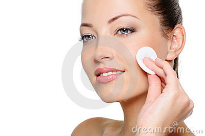 Beauty woman cleaning her face with cotton swab
