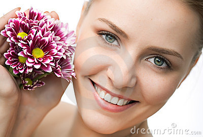 Beauty woman closeup portrait with flower