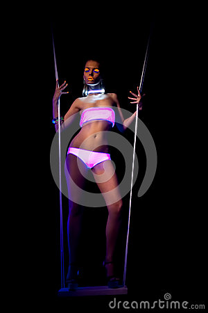 Beauty woman dance on swing with glow make-up