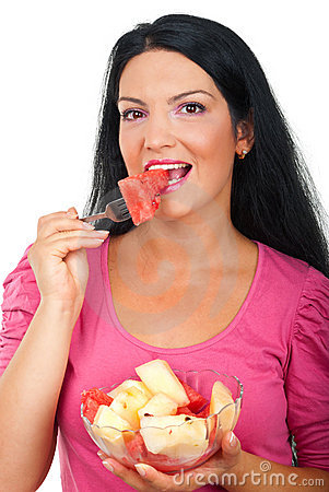 Beauty woman eating melons salad