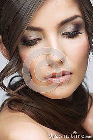 Beauty woman face close up portrait. Light make up