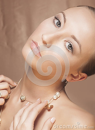 Beauty Woman Face. Elegant Golden Necklace with Pearls