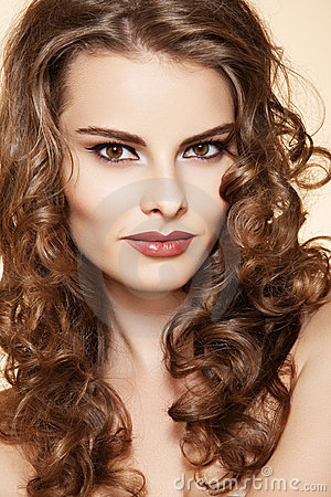 Beauty woman with fashion make-up, long curly hair